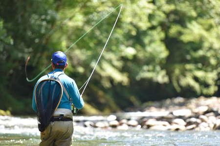 Flyfisherman 山川で釣り 写真素材