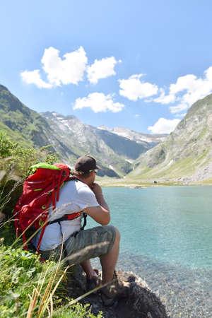 cirque: Hiker relaxing by Ossoue lake, Cirque de Gavarnie