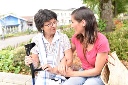 carer: Senior disabled woman and carer spending time together Stock Photo