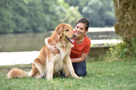 Woman relaxing with dog at the park