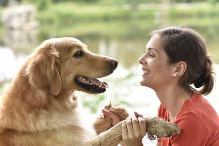 complicity: Complicity between woman and dog Stock Photo