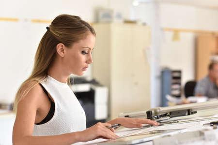 design office: Student girl in engineering training, design office