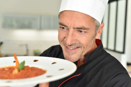 catering food: Restaurant chef presenting new dish