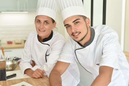 gastronomy: Cooking students in uniform attending training class