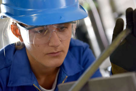 ironworks: Young woman in ironworks training course Stock Photo