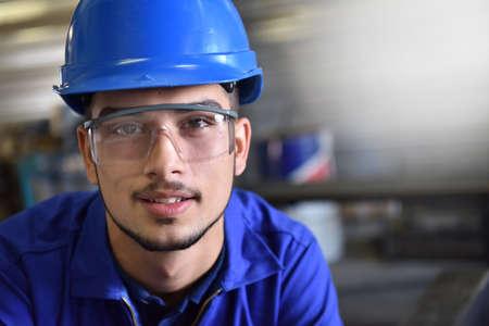 trainee: Portrait of young metalwork trainee in workshop