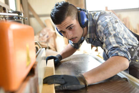 Young man in woodwork training course 免版税图像 - 67012753
