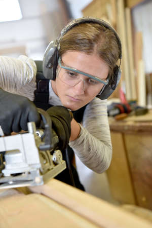 woodwork: Young woman in woodwork training course Stock Photo