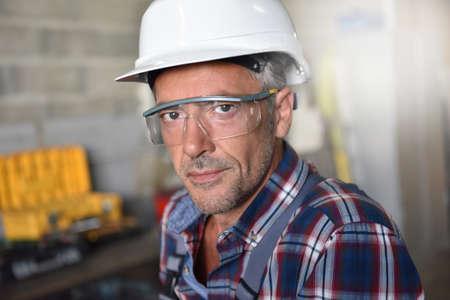 security helmet: Portrait of metalworker with security helmet in workshop
