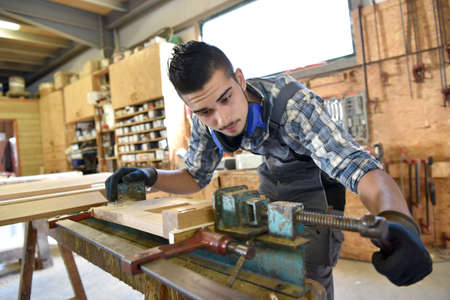 woodwork: Young man in woodwork training course