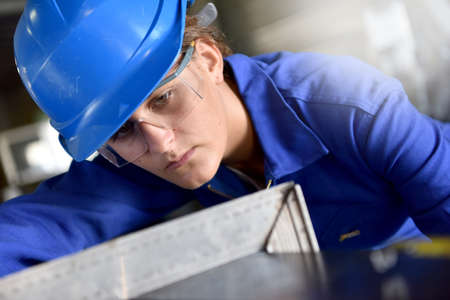 Girl attending metalworks training course Stock Photo