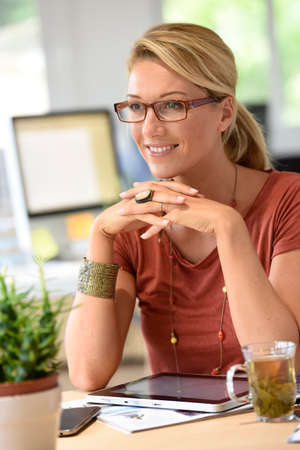 homeoffice: Attractive woman designer working from home-office