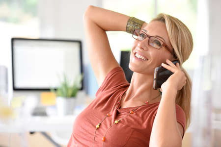 middleaged: Attractive blond middle-aged woman talking on phone
