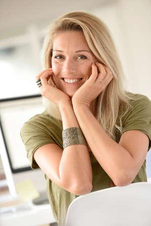 saleswomen: Portrait of beautiful blond woman in office