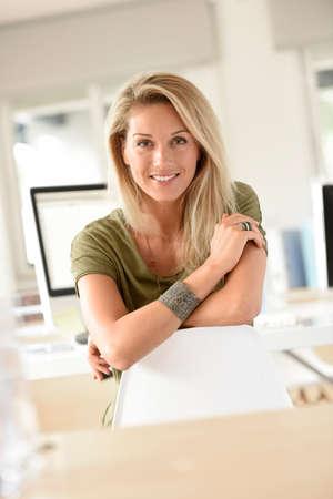 Portrait of beautiful blond woman in office