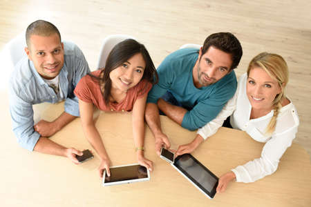 workers group: Upper view of start-up business people meeting with electronic devices