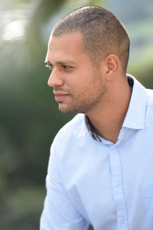 35 years old man: portrait of hispanic guy standing outside