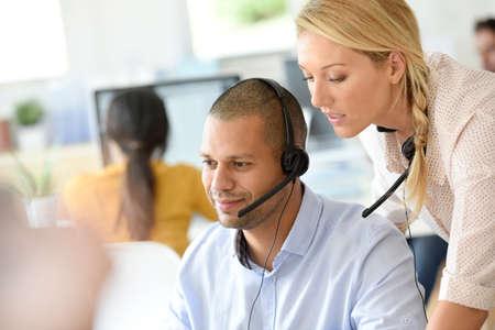 teleoperator: Teleoperator in office with manager Stock Photo