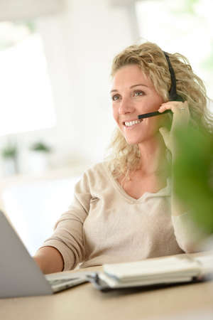 telework: Woman working from home-office, telework