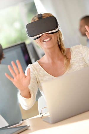 officeworker: Office-worker using VR headset, 3D, virtual reality