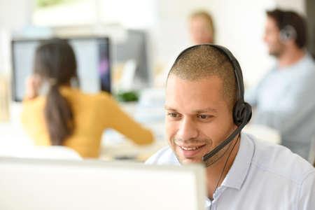 Customer service operator working in office 스톡 콘텐츠