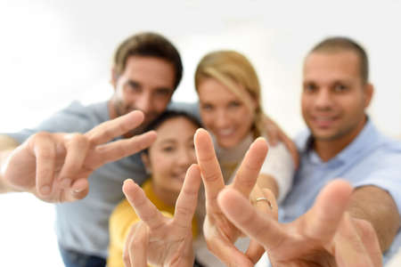 workteam: Group of people showing thumbs up to camera