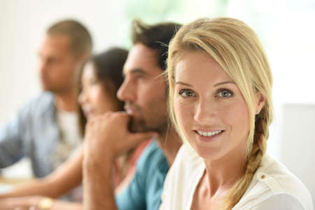 people together: Beautiful blond woman attending business meeting Stock Photo
