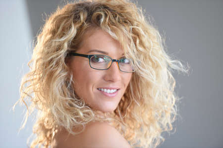 beleza: Portrait of attractive blond woman with eyeglasses, isolated Imagens