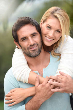 each: Attractive couple embracing each other Stock Photo