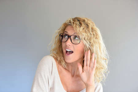 expressive: Portrait of blond woman with eyeglasses being expressive