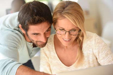 websurfing: Couple at work websurfing on internet