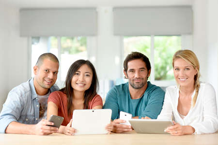 workteam: Start-up business people meeting with tablets and smartphones
