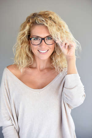 Portrait of attractive blond woman with eyeglasses, isolated Фото со стока