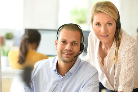 Teleoperator in office with manager Stock Photo