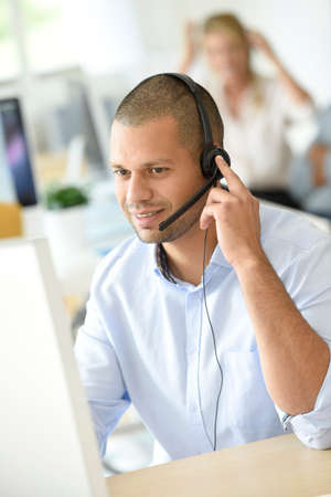 Customer service operator working in office Stock Photo