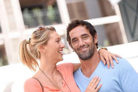 couples hug: Portrait of cheerful couple standing outside