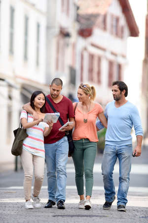 basque woman: Young people on vacation walking in city street Stock Photo