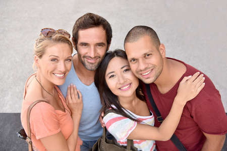 couples hug: Portrait of four young adults, ethnicity