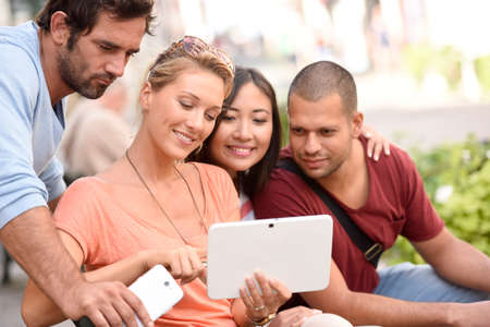 websurfing: Young people websurfing on digital tablet to find apartment