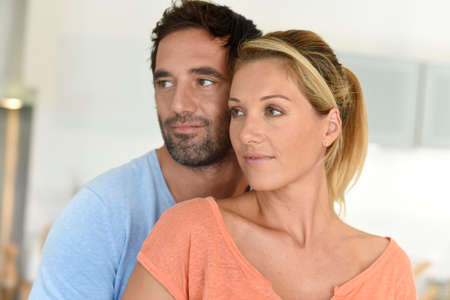 couples hug: Middle-aged couple relaxing at home