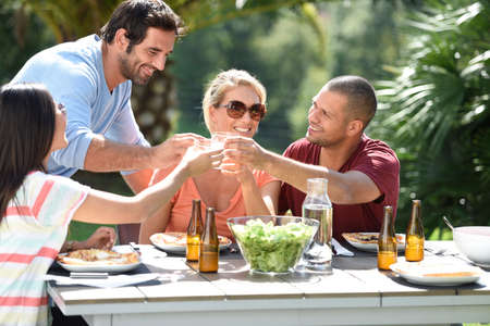 outdoor: Friends having lunch outside on a sunny day