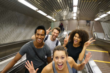 subway station: Group of friends having fun in subway stairs