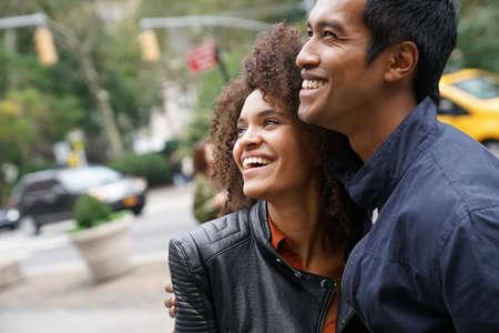 Ethnic couple walking in New york city street