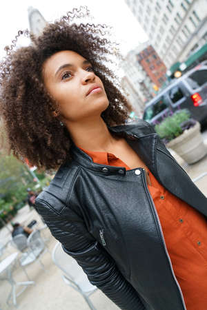 Portrait of mixed-raced girl waiting in street