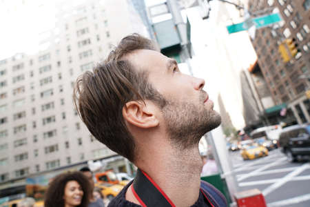 globetrotter: Portrait of man looking at New York city skyscrappers