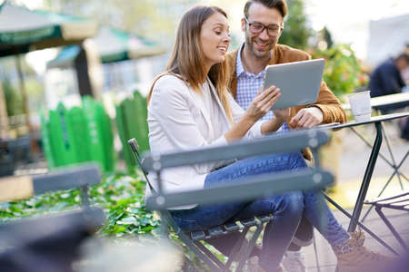 bryant: Couple at Bryant park using digital tablet