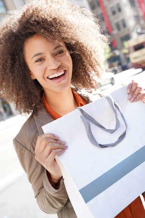 Cheerful girl doing shopping in New York City Stock Photo