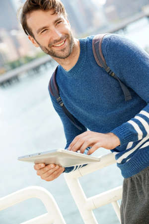 hudson: Man standing by the Hudson river, using digital tablet Stock Photo