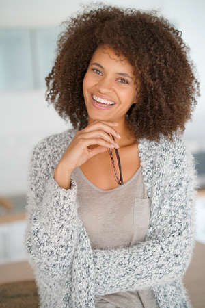 Portrait of attractive and cheerful mixed-race woman with eyeglasses