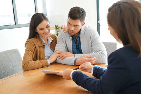 3 persons: Couple meeting financial adviser for home investment contract Stock Photo